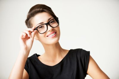 Girl wearing a spectacle smiling